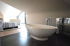 I choose the V Napoli double ended volcanic & limestone bath, such a beautiful feature piece, we even had to strengthen the floor to take the weight of it! The taps are Vado and the mirrored cabinets provide ample storage.
