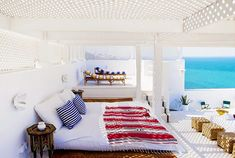 Open air, ocean view Moroccan bedroom // I wouldn't mind waking up to this every morning!