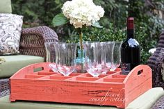 We love how Courtney from the French Country Cottage Blog used a rustic herb crate to gather wine glasses, bottles and flowers in her outdoor space. A great example of a small touch with a big impression.