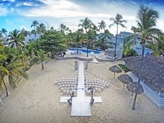 Aerial view of gazebo on the beach of Kukua Punta Cana, Dominican Republic. All set for perfect destination wedding. Photo by Milan Photo Cine Art