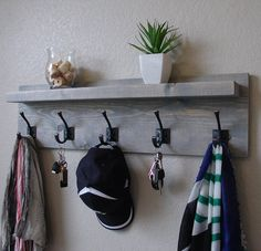 Handcrafted modern rustic coat rack with dark bronze hooks and floating shelf. Made from solid wood. It has been sanded down, then stained and sealed Rustic Coat Rack, Rustic Wine Racks, Deep Shelves, Wall Shelves, Cool Couches, Vintage Umbrella, Standing Coat Rack, Long Shelf