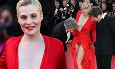 Now that's daring! Roman Polanski's wife Emmanuelle Seigner shows off eye-popping cleavage in a loud red dress (and matching underwear) in Cannes