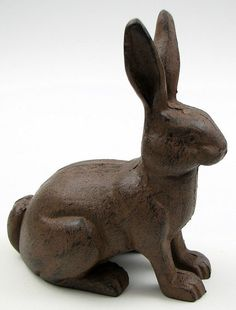 "Cast iron rabbit. Hollow inside. This little guy makes a great garden decoration, and you don't even have to worry about him eating the veggies. Details: - Measures 8.25""W x 9.25""H x 4.75""D. Condition"