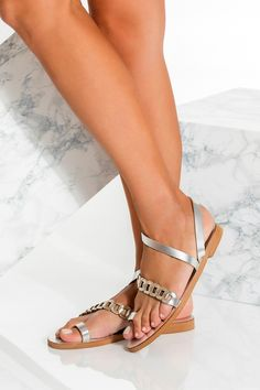 Classic with a twist Eve sandals featuring our signature chain strap with a plain toe ring and ankle wrap. Whether on vacation or in the city, they will complement any outfit in your summer wardrobe. These elegant flat sandals are the type you can wear instead of heels without feeling under-dressed. Handmade of the best quality leather they come in silver with gold details, gold, black, black with white, camel, blue with gold, white with silver. Find your perfect pair of flat shoes for… Leather Sandals Flat, Diy Bow, Toe Rings, Gladiator Sandals, Ankle Strap, Dancing, Greek, Crystal, Flats