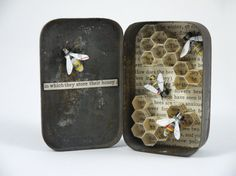 In which they store their honey ;  Materials used: Tin, beads, wire, thread, an old map and book pages. All these materials are recycled.  Dimensions