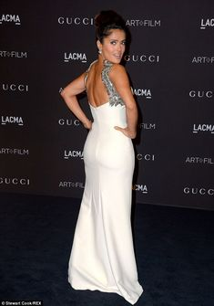 Off the shoulder: The 48-year-old displayed her incredible figure and wore jewels from Boucheron