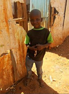 A little boy poses for my camera in Kibera, Africa's largest slum.