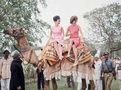 Jackie Kennedy and sister Lee Radziwill on their trip to India, on top of a camel.