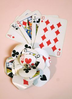 diy Playing Card Flower - this will go perfectly on my dress i'm making!!!