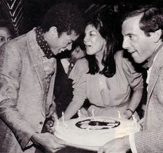"""Michael Jackson, Carmen D'Alessio and Steve Rubell at Michael Jackson's 21st Birthday Party at Studio 54. August, 29, 1979. Germany 2014: Exhibition """"Excess In Black And White"""", photos by Tod Papageorge at the Gallery Thomas Zander, Cologne"""