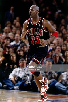 Michael Jordan of the Chicago Bulls jogs up court wearing his original Nike sneakers against the New York Knicks during his final game at Madison. Mike Jordan, Jordan Bulls, Michael Jordan Basketball, Jordan Logo, Michael Jordan Sneakers, Jordan Poster, Michael Jordan Pictures, Michael Jordan Photos, Nba Pictures