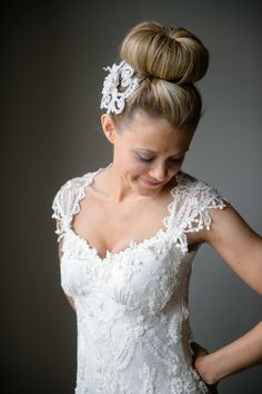 Say yes to a chic bridal bun #hairstyle Photography: Averyhouse - averyhouse.net Read More: http://www.stylemepretty.com/2014/08/15/classic-meets-modern-indiana-wedding/