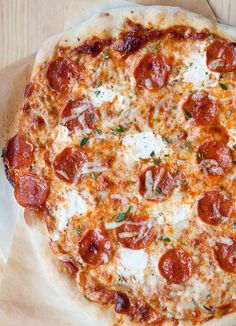 3 Cheese Rosemary and Pepperoni Pizza Recipe - The rosemary really took this pizza a step up! It was suuuper delicious. I used pillsbury pizza crust and pre-shredded cheese, so it was a really easy recipe that took barely any prep work, and easy clean up too.