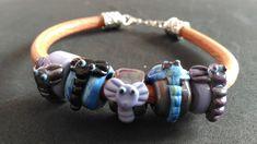 Handmade Lampwork Bracelet with elephants and made with genuine leather. Handmade Beads, Handmade Bracelets, Cuff Bracelets, Tiny Necklace, Glass Necklace, Bracelet Making, Elephants, Brown Leather, Cuffs