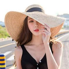 https://www.buyhathats.com/summer-raffia-sun-hat-women-floppy-wide-brim-beach-hats-bow.html