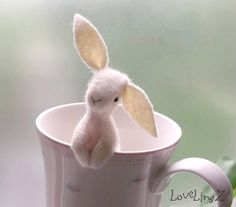 Peek-a-boo!!    This cute little LoveLingZ bunny could pop up out of your coffee mug, sitting in your pocket, or peeking over your laptop screen,