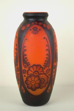 the cased orange glass overlaid in black with floral motif, signed Muller Fres Luneville, 14in.
