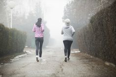 Mother and daughter going for a run on misty morning