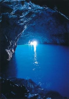 The Blue Grotto, Capri. This tunnel gets it's blue glow from the sunlight reflecting the water outside, which the same water then flows through the opening to the grotto, and gives it a magical glow.