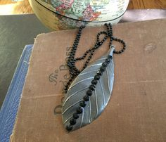 Leaf Necklace // Single Leaf Necklace // Hammered Metal Leaf Necklace with Black Crystals // Black Ball Chain adjustable up to 24 inches by RevealedTreasuresByL on Etsy