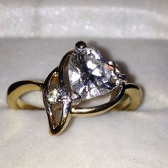 Heart shape CZ on 18k gold tone setting. Heart shape CZ ring gold tone setting.  Not real gold. Not sure what type of metal.  Great costume jewelry with a real look. Jewelry Rings