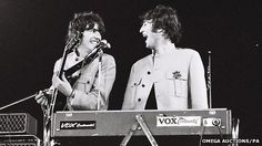 George Harrison and John Lennon at the Beatles' 1965 concert at the Shea Stadium in New York. Photo by Marc Weinstein.