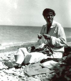 Eleanor Roosevelt knitting on the beach at Campobello Island