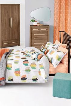 Add some playful prints into your bedroom in time for the warmer weather with this rich retro tulip bed set from Next.