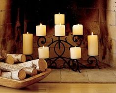 I need one of these! I have candles in my fireplace but would love a tiered candelabra for them... and a mirror back drop!