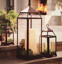 Spray paint lantern black and add succulents.