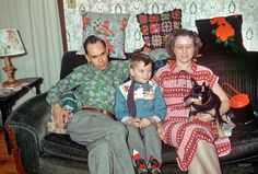 """The Cowboy Kid: Floyd, Loren, Dottie & Boots at Folks -- Jan 20 1952.""""  With Loren sporting six-gun sox and snug as a bug in a rug. 35mm slide by Hubert Tuttle."""