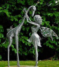 Wired to the Moon Unique Wire Sculptures Fairy with giraffe Chicken Wire Art, Chicken Wire Sculpture, Wire Art Sculpture, Outdoor Sculpture, Wire Sculptures, Herb Garden Pallet, Metal Garden Art, Metal Art, Fantasy Wire