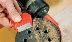 """When the """"loops"""" on a sander's hook-and-loop pad become clogged with dust, the sanding discs won't cling properly. Here's a simple fix."""