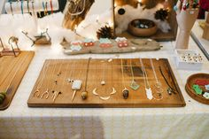 This is a great (and cheap!) way to display necklaces - pin them onto a wooden board!