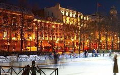 Oslo with ice skating rink in middle of town around Christmas
