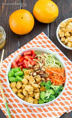 Crispy crunchy orange tofu in an Asian inspired Buddah bowl.This mountain of fresh veggies will fill you up without weighing you down. The orange tofu is seriously addicting and will soon be your new favorite dish! Vegan, gluten free and easy to make!   www.pancakewarriors.com