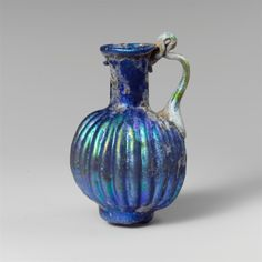 Roman, Glass juglet with vertical ribbbing, 2nd half of the 1st century (source).
