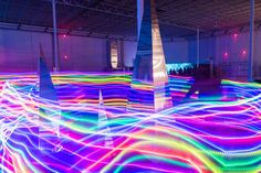 An LED hula hooper lent a spectrum of light to the reflective III Points sculpture by Dalva.