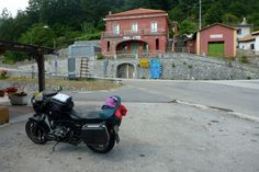 The red-coloured road inspector's house in the middle of the junction for Lagonegro and Latronico at Pecorone's zone.