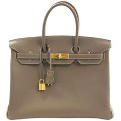 Pre-owned HERMES Etoupe Clemence Birkin Bag- Taupe Color with Gold HW... (22,385,475 KRW) ❤ liked on Polyvore featuring bags, handbags, handbags and purses, hermes birkin bags, top handle bags, gold bag, brown bag, pre owned handbags, top handle bag and gold handbag