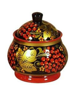 A wooden pot is decorated with Russian folk Khokhloma painting.