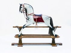Stevenson Brothers knows how to do childhood right. Check out their gliding rocking horses.