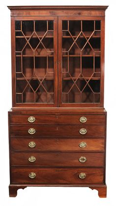 Charleston Federal Figured Mahogany Desk and Bookcase - South Carolina, circa 1800, removable dentil-molded cornice, upper case with glazed doors and adjustable shelved interior, lower case with fitted butler's desk with false double front, urn and leaf inlaid prospect door over three dovetailed long drawers set with original brasses, red cedar, white pine and other mixed secondary woods (possibly yellow pine and cypress), 95-1/2 x 49 x 23 in.
