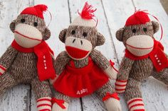 Sock monkey ornaments - with the kid's names on them! What a fun idea.
