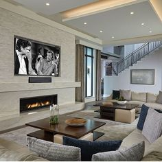 Sleek, elegant, & cozy all at the same time! From @thedecoratorsunlimited! #livingroom #familyroom #fireplace #rug #pillows #decorativepillows #coffeetable #homedecor #homedesign #interiordesign #realestate #dreamhome #inspo #decor #beautifulhomes #luxury #goals #follow #design #luxuryhomes #luxuryrealestate #contemporarydesign #moderndesign