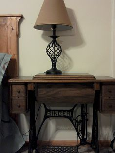 antique sewing machine table as bedside table, this was my great grandmothers.
