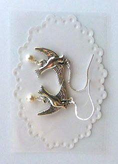 Most Beautiful Dove Bird Earrings Made With Swarovski Pearls And Sterling #SwarovskiWhitePearls #DropDangle