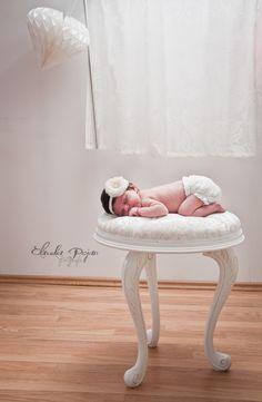 Newborn on vintage chair photography