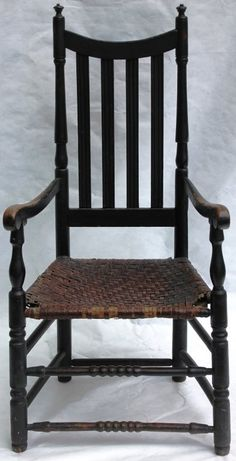 """18TH C YOKE BANNISTER BACK ARM CHAIR WITH TURNED STRETCHERS; OLD BLACK FINISH; MAPLE WITH ORIGINAL SPLINT SEAT; 47"""" HIGH, 22 3/4"""" WIDE, 19"""" DEEP; SEAT HEIGHT 17""""; DESCENDED THROUGH CONNECTICUT FAMILY"""
