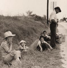Great Depression Era: A family that has lost everything waits by the highway in the hope of hitchhiking a ride out of town. Macon, Georgia. 1937